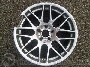 001. BMW CSL Alloy Wheel needs rebuilding as a chunk of Aluminium has broken off & is missing.