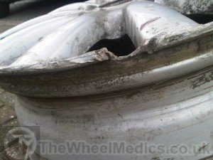 002. Alloy Wheel needs rebuilding as a chunk of Aluminium is missing
