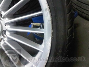 002. BMW Alpina 20'' Alloy. Buckled and Bent on face