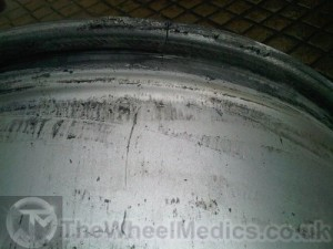 004. Alloy Wheel is Cracked along bead line causing air lose