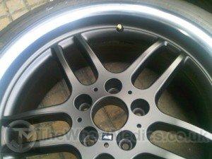 010. BMW. Satin Black with a Polished Lip
